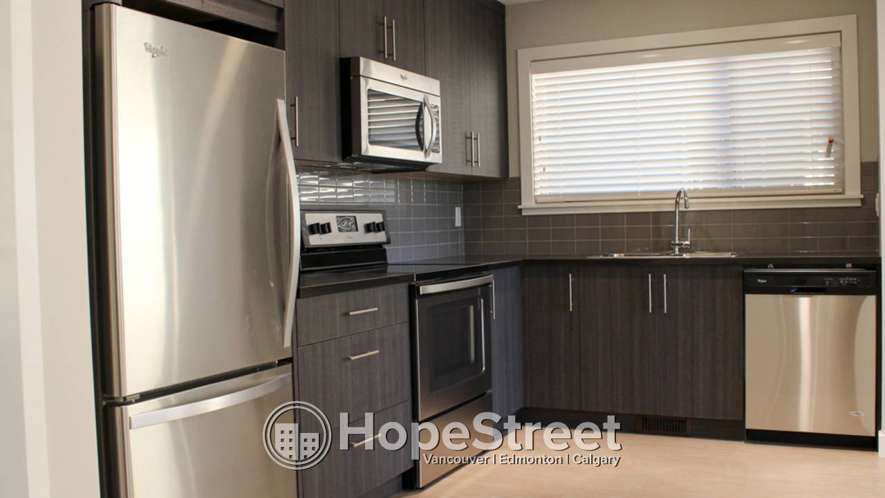 3 Br Townhouse for Rent in Cochrane: Pet Negotiable/ TWO PARKING STALLS.