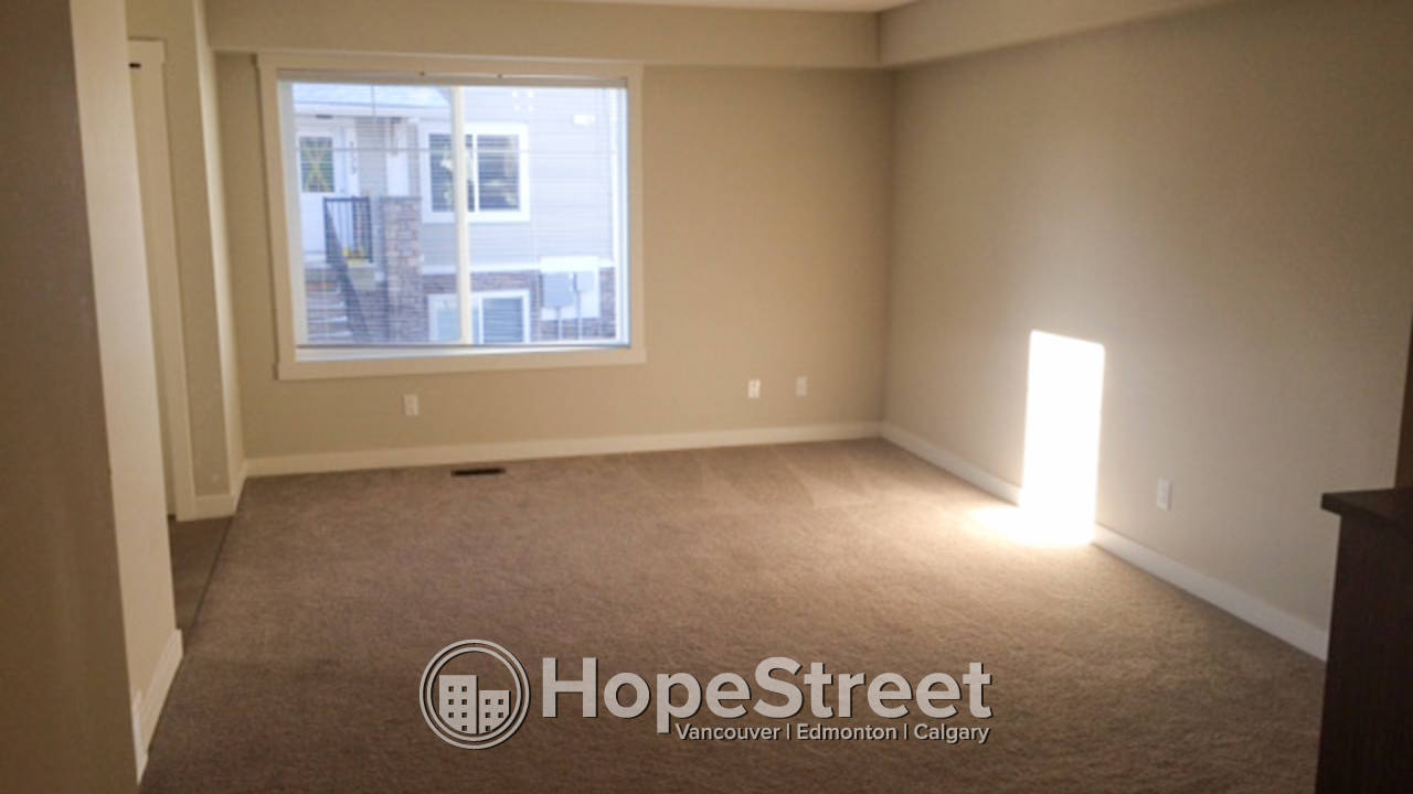 2 bedroom apartment in chestermere pet friendly hope street real estate corp for 2 bedroom pet friendly apartments