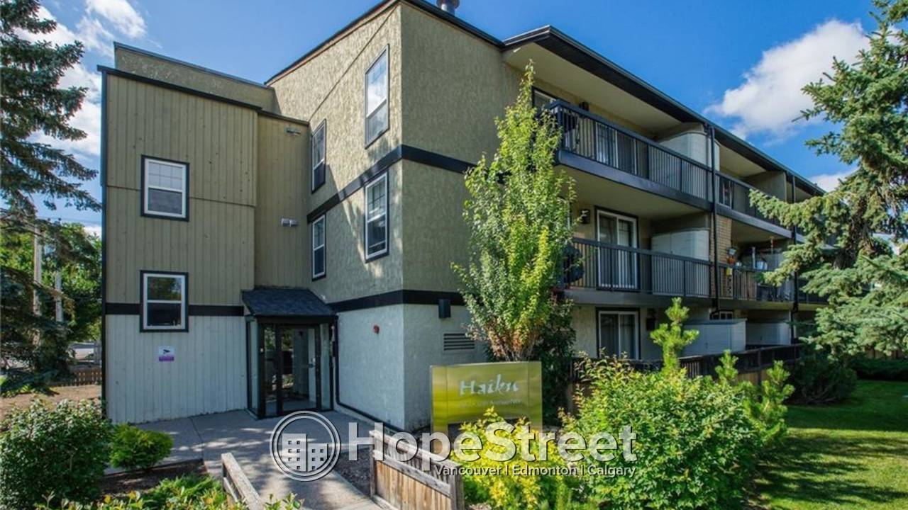 Fabulous 1 BR unit with in-suite laundry and titled covered parking.: Heat & Water Included