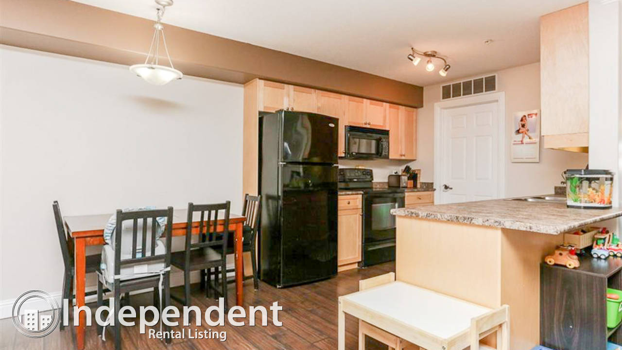Very well maintained 2 BR - end unit w/ UNGRD. PARKING & UTIL. INCLUDED