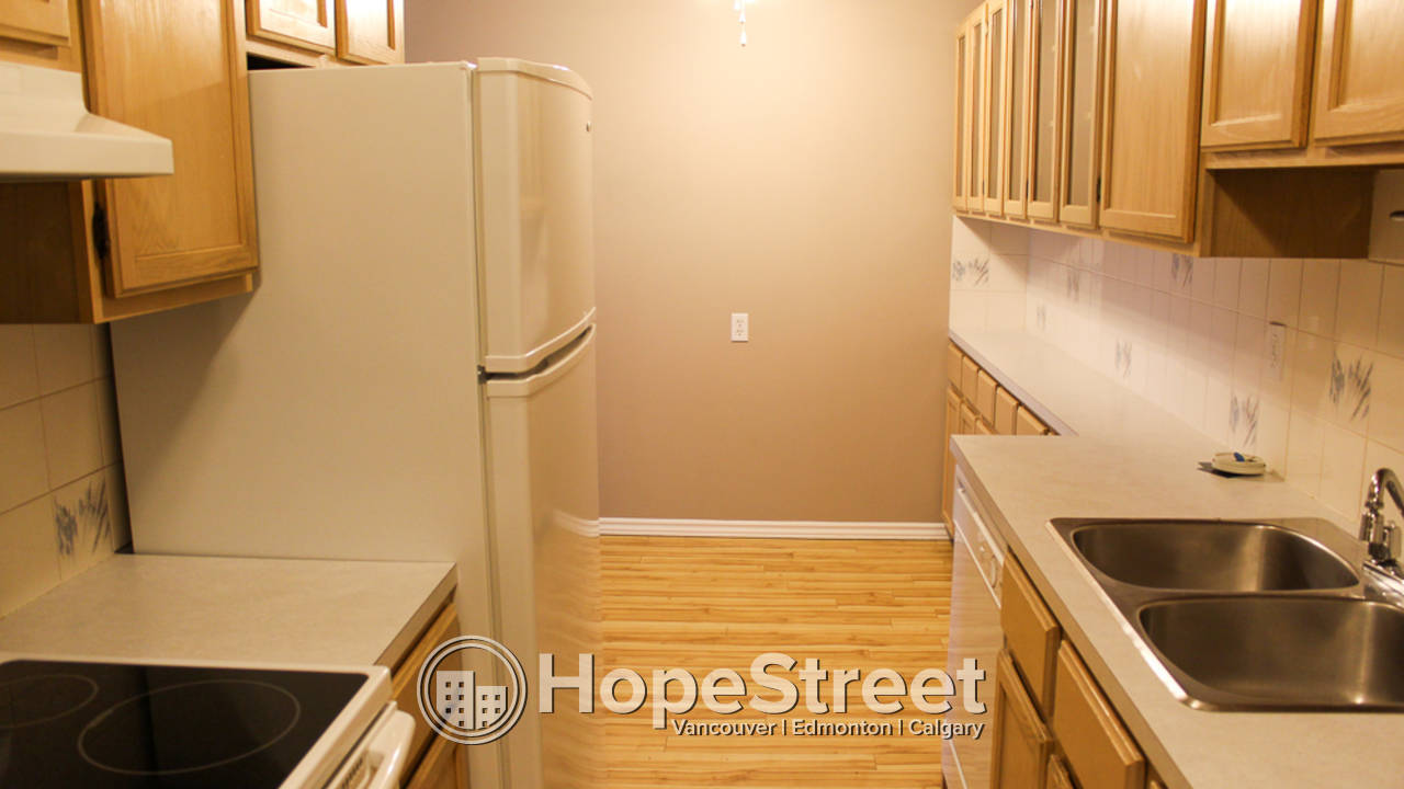 2 BD Condo for Rent in Bankview: Pet Friendly & Utilities Included