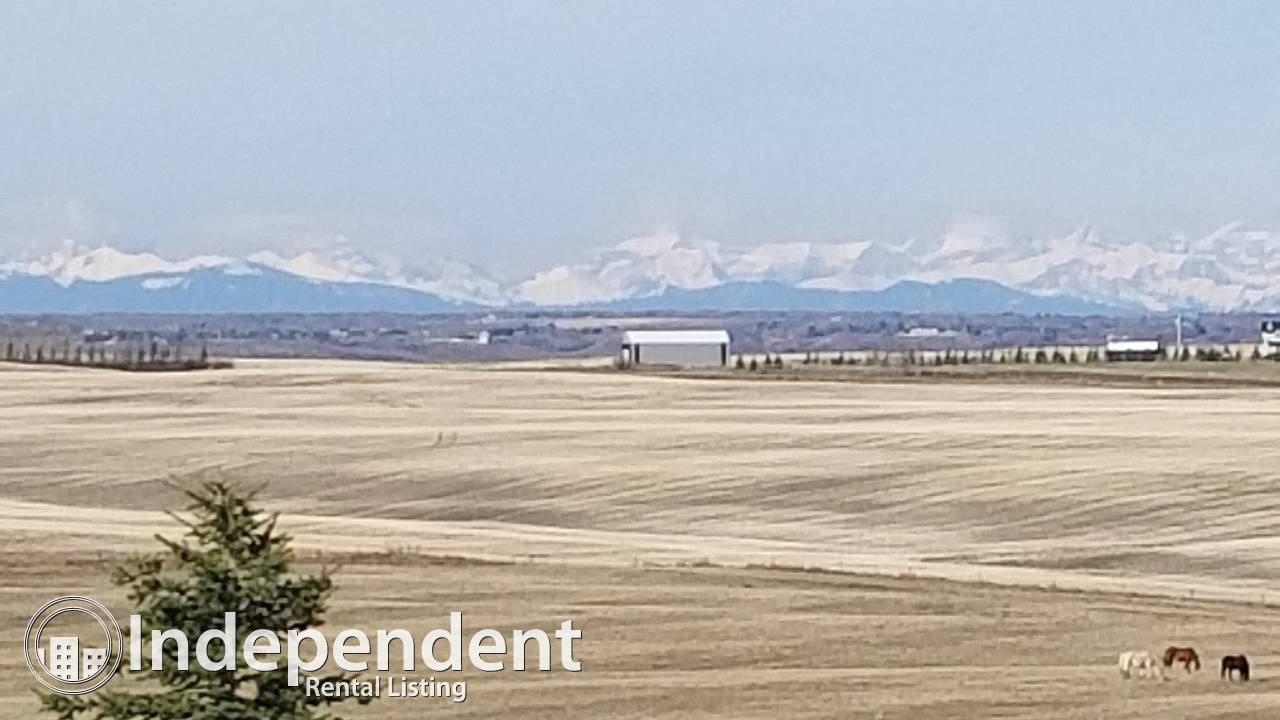 Gorgeous Mountain Views from this Country style home on an acreage close to North Calgary and Airdrie.