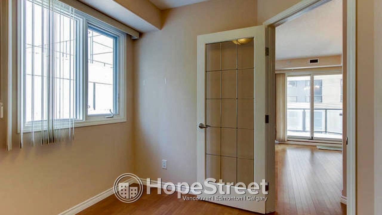 1 Bedroom + Den Condo in Downtown w/ Undgr. Parking & Utilities Included