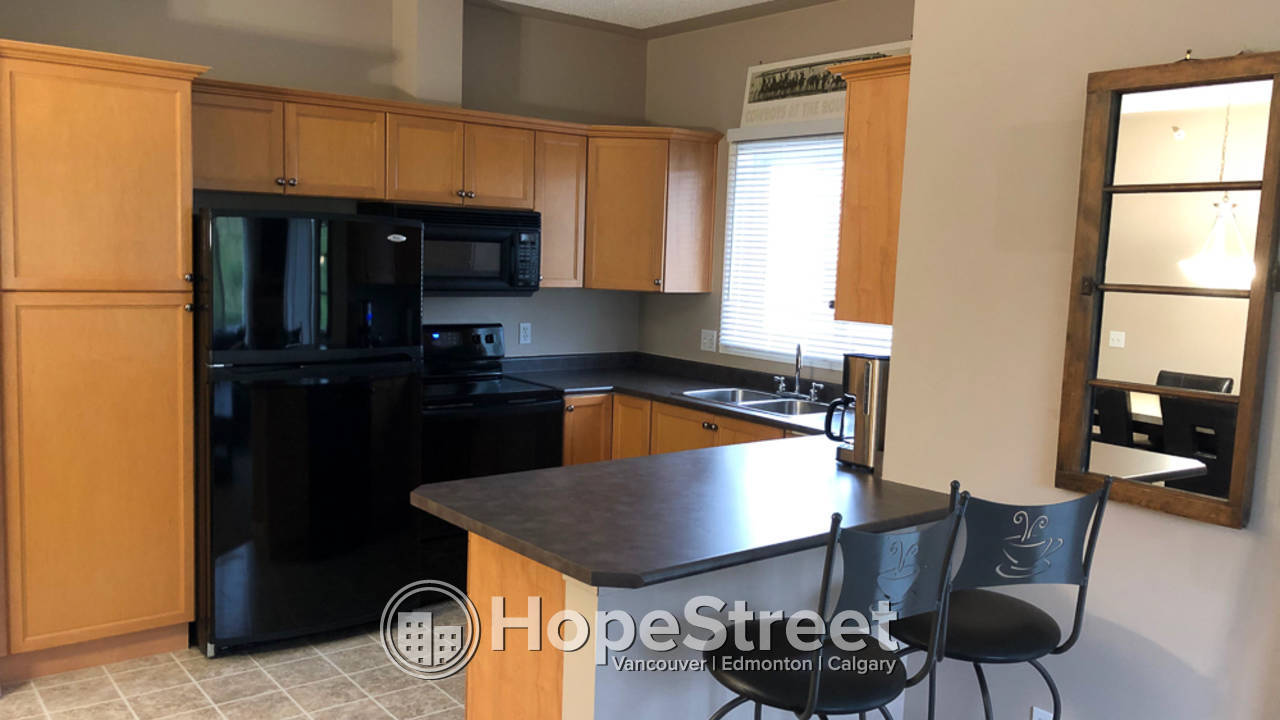Fully furnished, Fully Equipped and Move In Ready 2 Bedroom Condo in Rocky Ridge