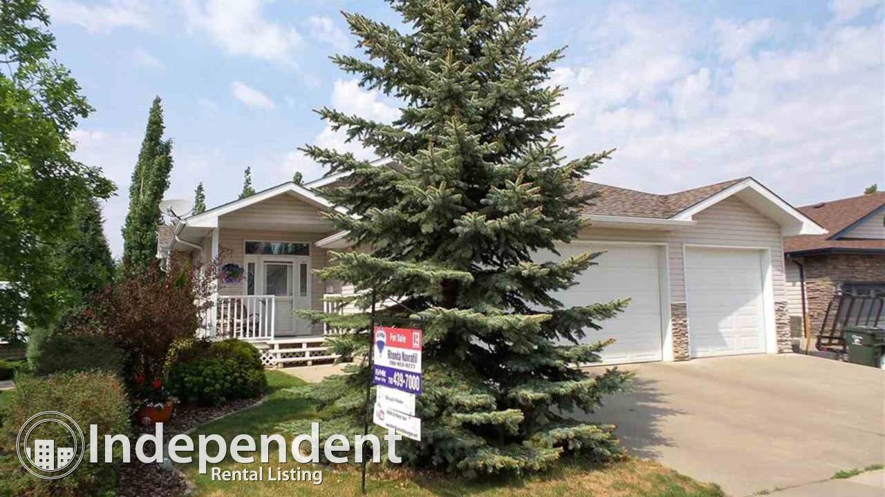 WONDERFUL LOCATION - BACKING A HUGE PARK - WALK OUT BUNGALOW.