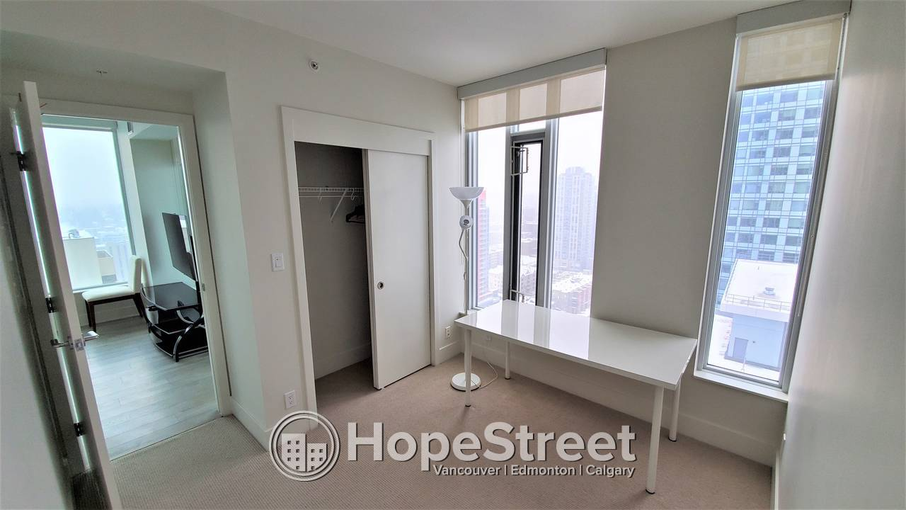 PARTIALLY FURNISHED 2 BR Apt. in the Heart of the CITY w/ UNDGR PARKING