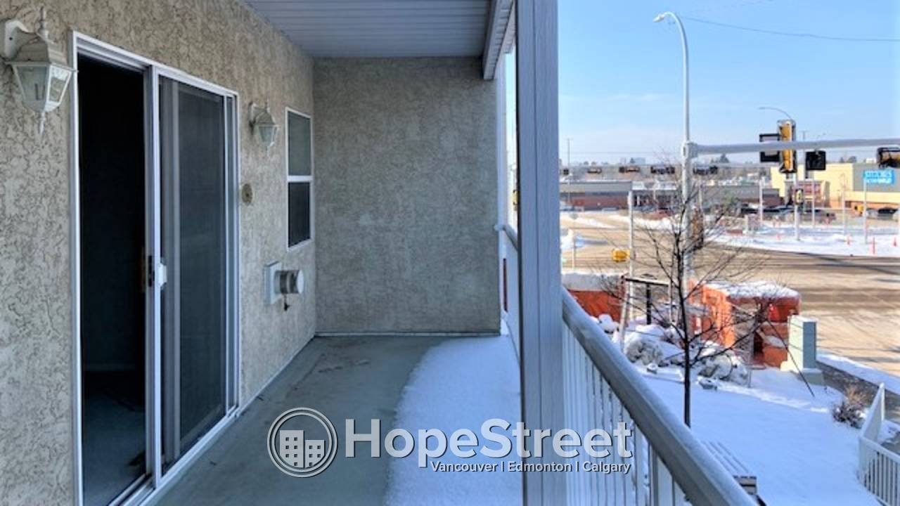 2 BR Condo in TERRIFIC LOCATION ACROSS from BONNIE DOON MALL. 50+ BLDG