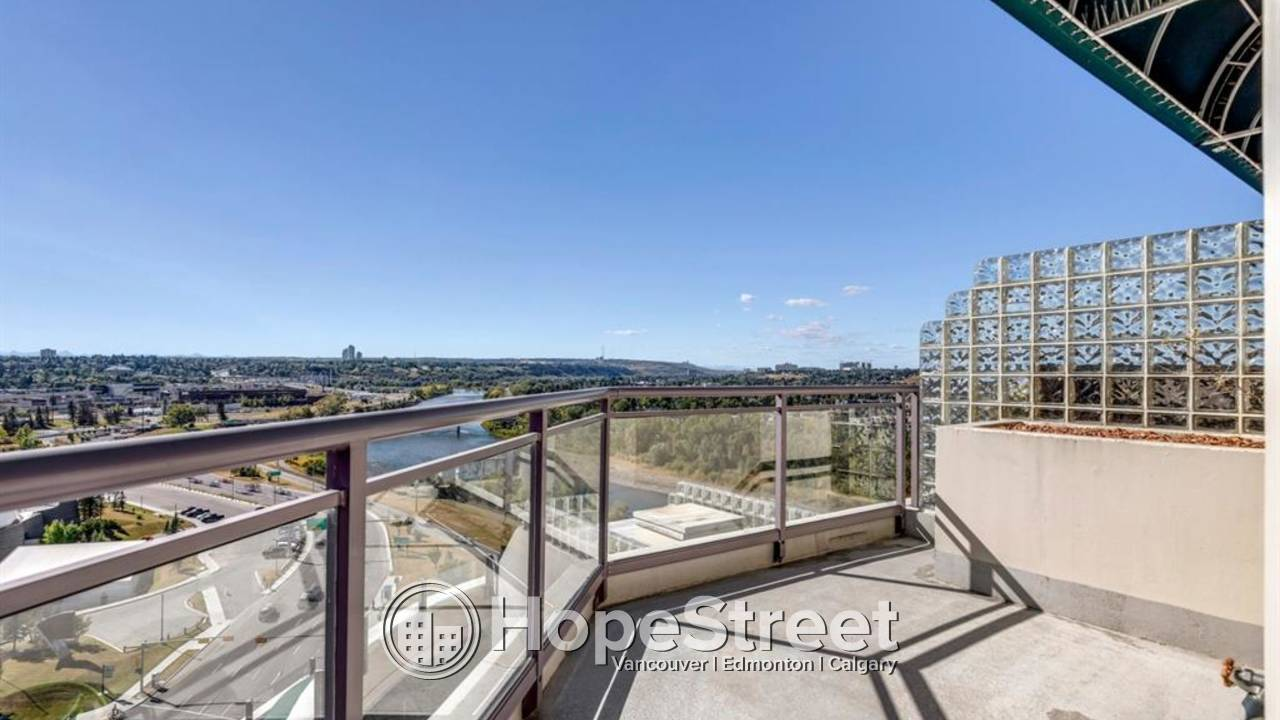FABULOUS 3 BR CORNER Unit with VIEWS of Downtown, Mountain & River