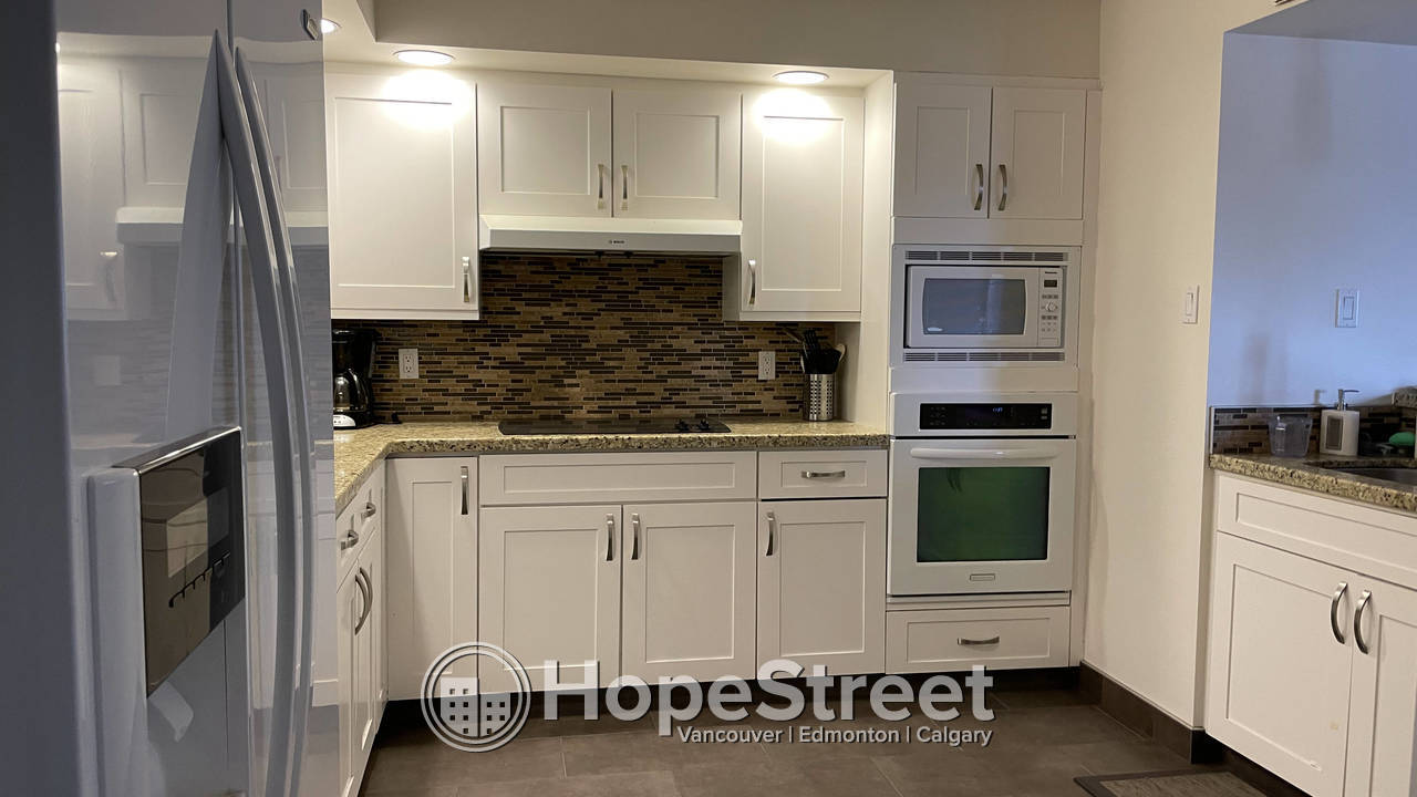 Large Executive Condo unit in Westmount Place/ Heat & Water Included.