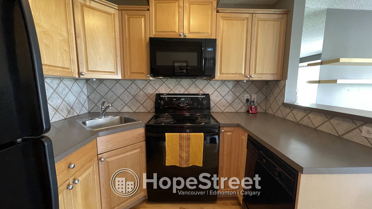 1 BR Condo in Beltline/ Heat & Water Included/ In-Suite Laundry/ Parking Stall..